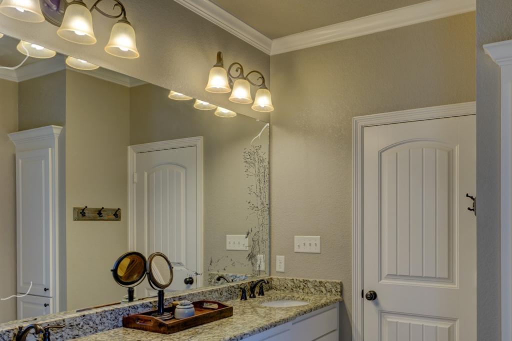 scratched desilvered bathroom mirror needs Baytown residential glass repair